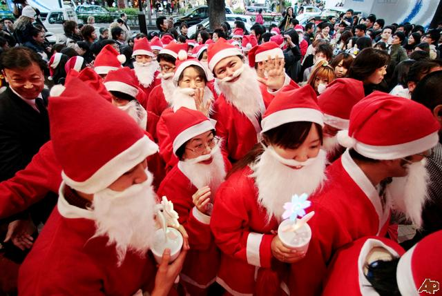 Japanese people dressed as Santa Claus in Tokyo