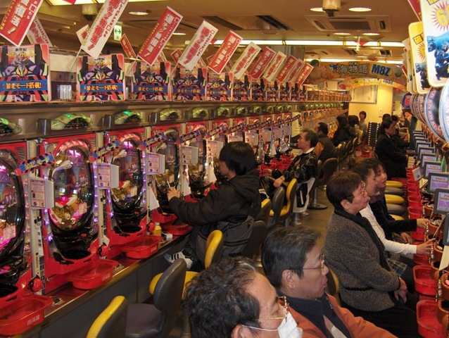 Pachinko parlor with a lot of Japanese people playing