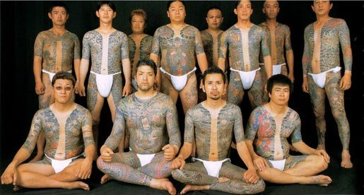 Yakuza group with traditional tatoos