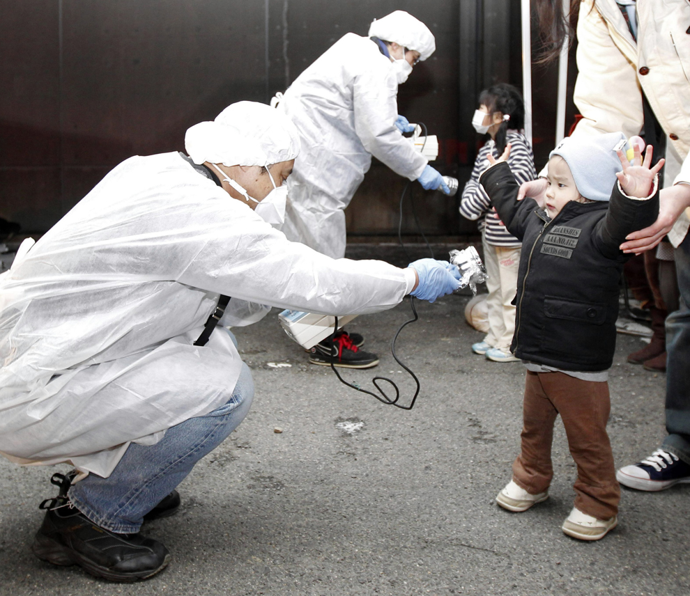 Little boy get controled for Fukushima nuclear plant after Japan earthquake