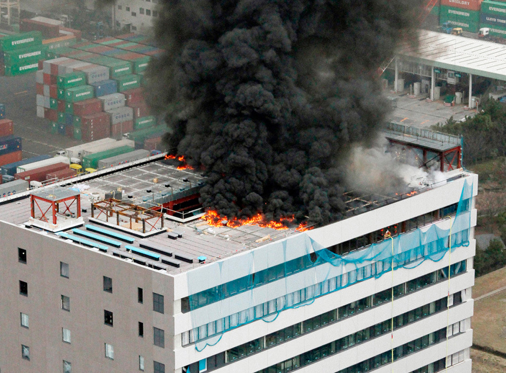 A building in fire after earthquake in Tokyo-Japan