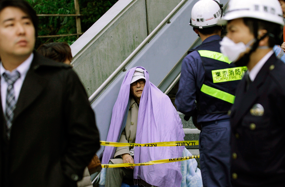 Man resting after earthquake in Japan