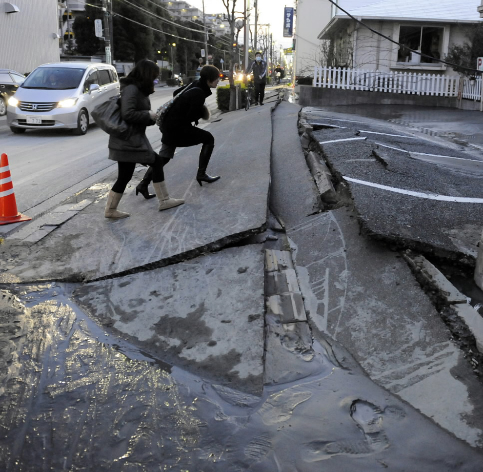 Girls walking on street destroyed after Japan earthquake