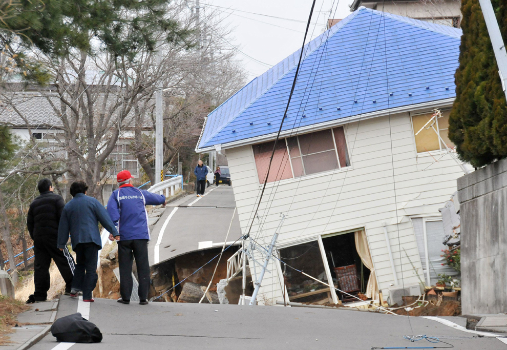 A house collapsed inside the road after Japan earthquake