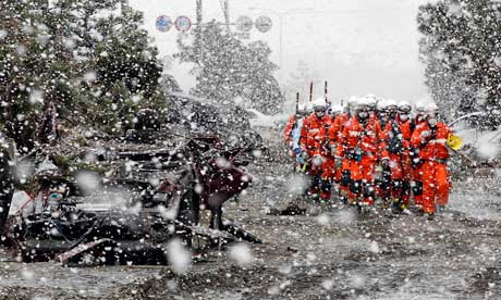 Japanese heroes march into damaged fukushima daiichi nuclear plant while snowing in Japan