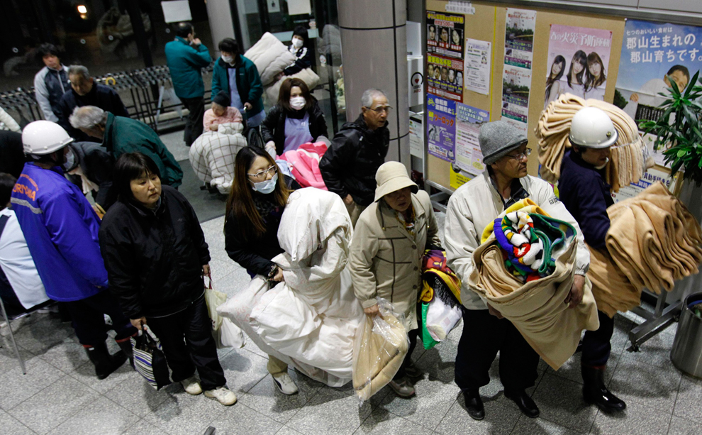 Japanese in queue to go sleep in a safe place after earthquake in Japan
