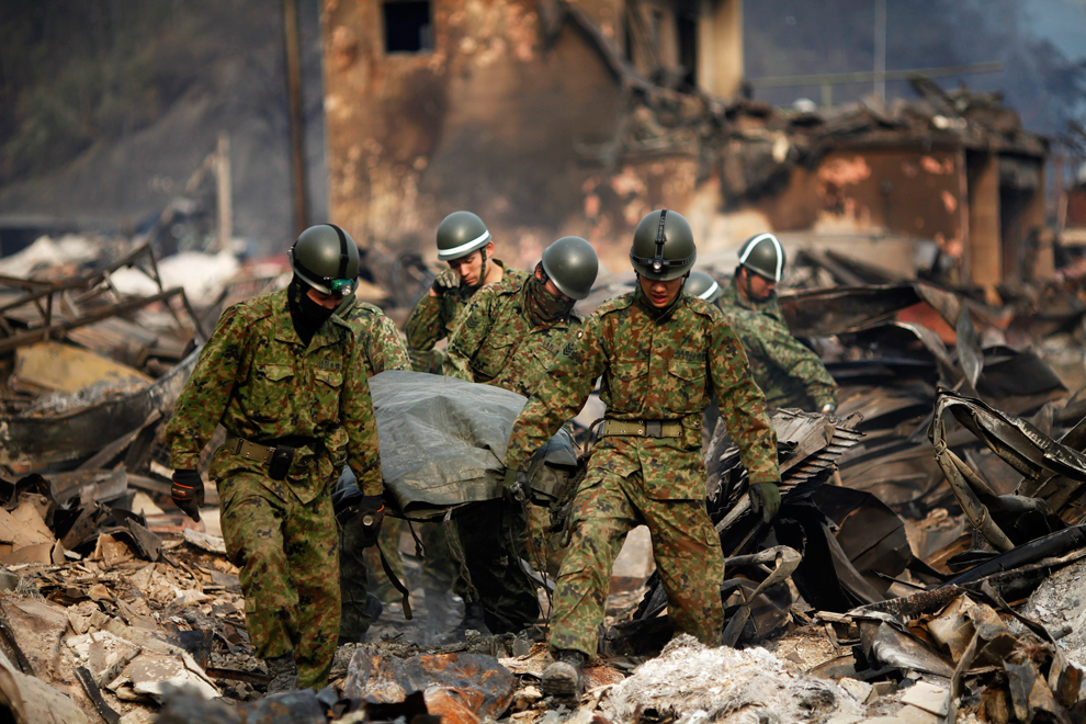 Rescue teams help people in Japan after the earthquake