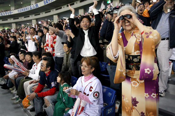 Japanese Baseball fans watching a game