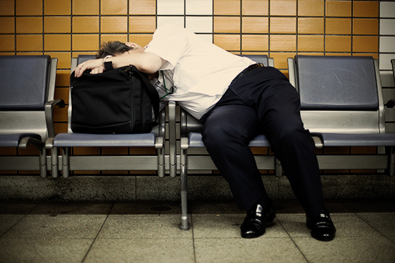 A businessman sleeping in a Tokyo metro station